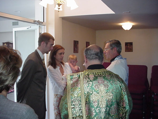 Young George is baptized into Christ