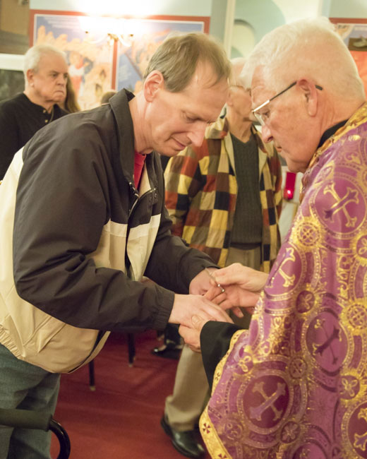 Father Paul anoints parishioner with the Oil of Holy Unction .