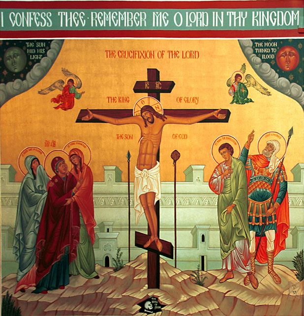 An icon of the crucifixion is on the wall near the altar.