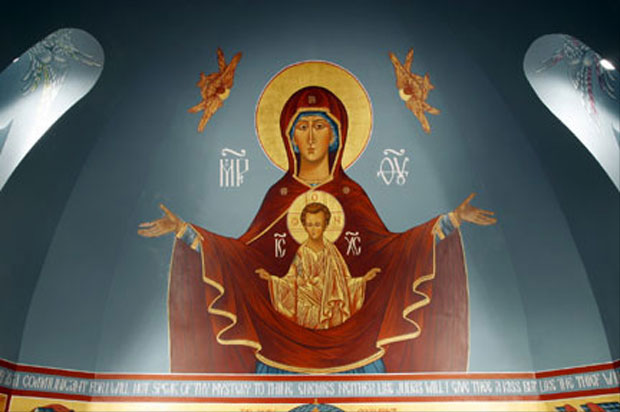 An icon of the Theotokos looms over the altar in St. Luke.